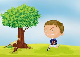 en pojke och ett träd