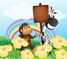 Ein Affe und ein Zebra am Garten mit einem leeren Brett