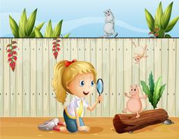 Vilda djur och en tjej med förstoringsglas vektor