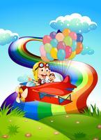 Verspielte Affen im Flugzeug mit Luftballons
