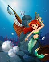 Ein Meer mit einer Meerjungfrau nahe dem zerstörten Boot