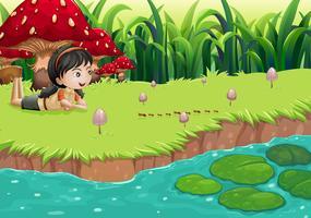 En flicka vid floden nära röda svampar