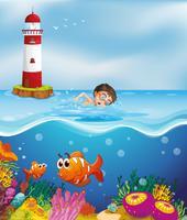 En pojke som simmar på stranden med en fyr vektor