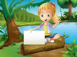 Ein Mädchen, das über einem Klotz mit einem leeren Signage sitzt