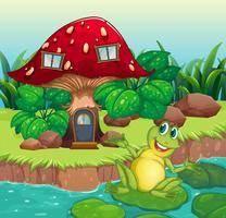 Ein Frosch und ein Pilzhaus vektor