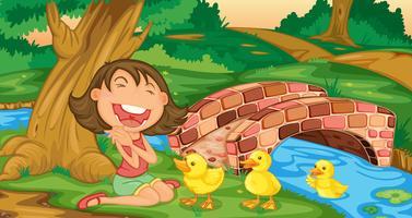 Mädchen trifft Entenküken