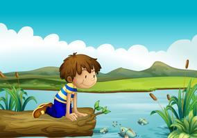 En ung pojke som tittar på fiskarna vektor