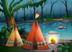 Traditionella indiska tält i skogen