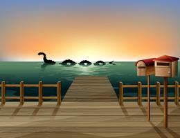 Sonnenuntergang am Hafen mit zwei hölzernen Briefkästen vektor