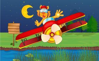 Ein Tiger, der in einem roten Flugzeug reitet vektor