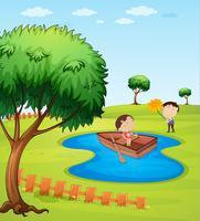 Kinder und ein Holzboot