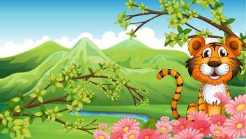 Ein Tiger nahe den Blumen über den Bergen