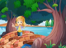 Ein Mädchen an der Brücke in der Nähe der riesigen Bäume