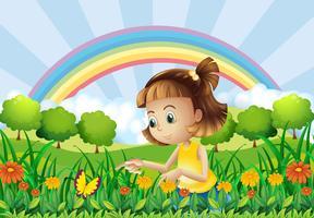 En tjej i trädgården med en regnbåge på baksidan vektor