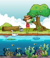 En pojke som fiskar vektor