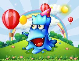 En kulle med ett lyckligt blått monster som håller en gul ballong vektor