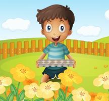 Ein Junge im Garten, der eine leere Eierablage hält vektor