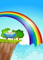Eine Untertasse an der Klippe und ein Regenbogen am Himmel