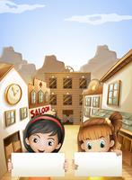 Zwei Kinder nahe den Saalstangen, die zwei leere Schilder halten