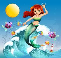 Eine große Welle mit einer Meerjungfrau und einer Fischschwarm
