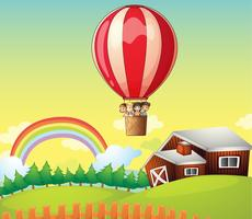 Barn i en luftballong och ett hus