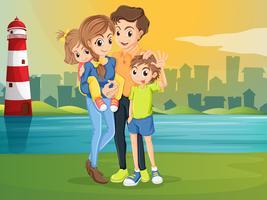 Eine Familie gegenüber dem Leuchtturm