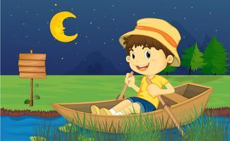 Ein Junge, der in einem Boot reitet