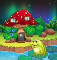 Ein Frosch in der Nähe des riesigen roten Pilzhauses vektor