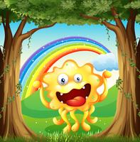 Ett monster på skogen med en regnbåge i himlen