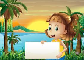 Ein kleines Mädchen, das einen leeren Signage hält