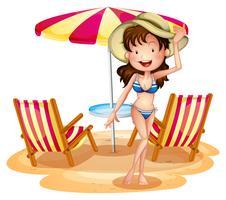 En tjej framför paraplyet med stolar