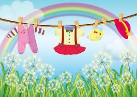 Barnkläder hängande nära gräset vektor