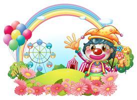 En kvinnlig clown vinkar händerna nära trädgården
