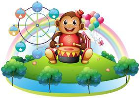 Ein musikalischer Affe nahe dem Riesenrad vektor