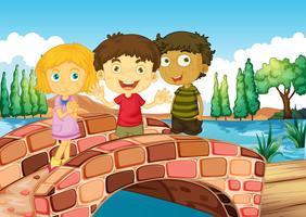 Drei Kinder an der Brücke