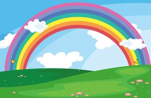 Eine grüne Landschaft mit einem Regenbogen im Himmel vektor