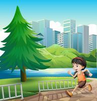 Ein junges Mädchen, das am Flussufer läuft vektor