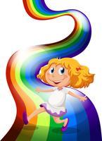 Ein junges Mädchen, das am Regenbogen spielt vektor