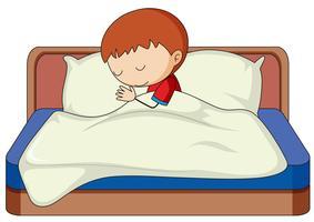 En pojke som sover på sängen
