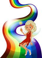 En leende älva ovanför regnbågen vektor