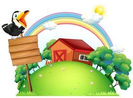 En fågel på toppen av en träskylt framför ett hus