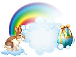 Ein Kaninchen und ein Ei in der Nähe des Regenbogens