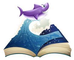 En bok med en bild av en våg och en haj