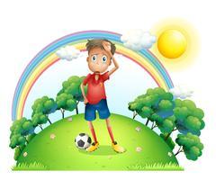 Ein müder Fußballspieler an der Spitze des Hügels