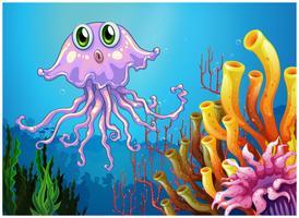 Eine süße Qualle in der Nähe der Korallenriffe vektor