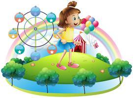 En ung tjej på nöjesparken vektor
