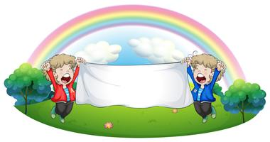 Två barn på kullen med en tom banner