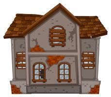 Backsteinhaus mit zerstörten Fenstern