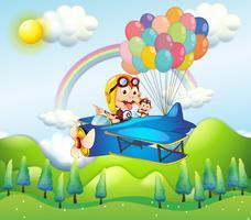 Zwei Affen, die in ein Flugzeug mit bunten Ballonen reiten
