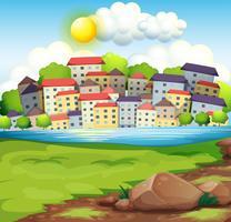 En by nära floden vektor
